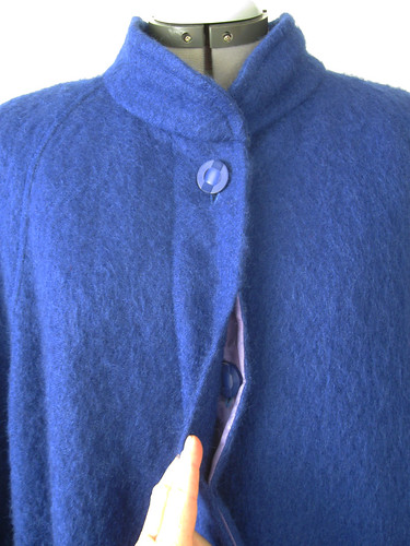 Blue coat hidden buttonhole closure