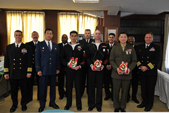 Members of the Yokosuka City Police Department and U.S. service members pose for a photo during a ceremony held Nov. 14 to recognize them for their contribution to police activities. (U.S. Navy Photo by Mass Communication Specialist 2nd Class Adam K. Thomas)