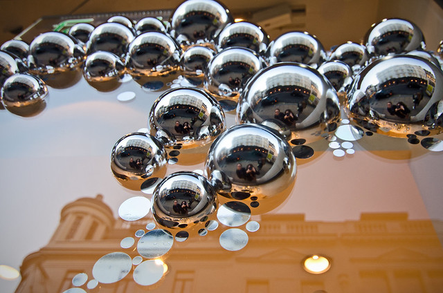 Mirrored bubbles in a shop window near London's Mayfair neighborhood.