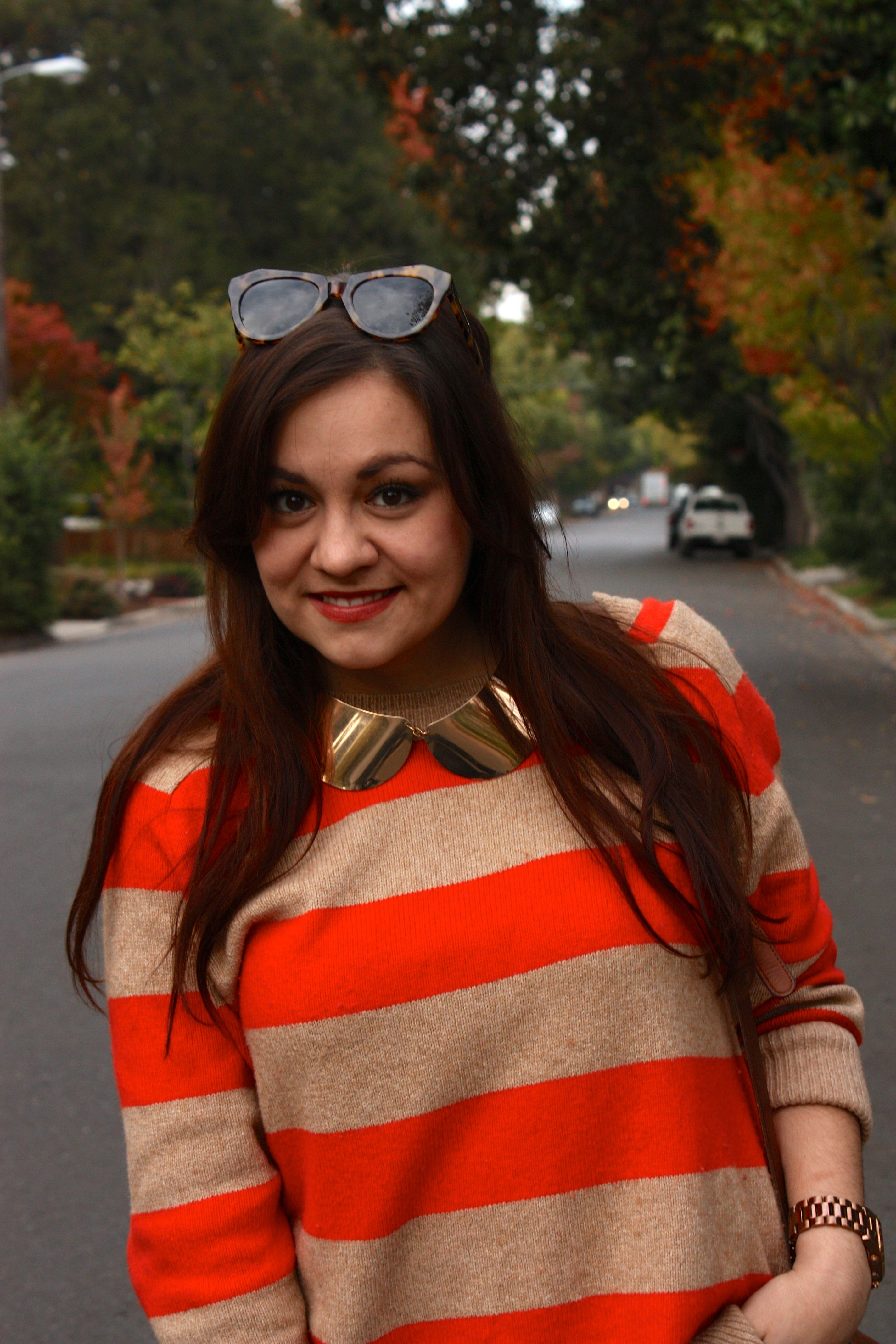 orange striped sweater with gold peter pan collar necklace and karen walker number one sunglasses