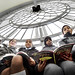 Children read behind clock face of Elizabeth Tower as part of Parliament Week's 'Somewhere Special to Read'