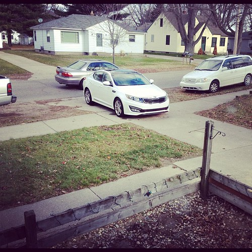 Our driveway is a parking lot lately - but oooooh! Look what showed up today? The 2013 #Kia. I will drive you.