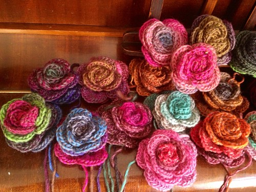 Crochet rose flowers nestling on the piano
