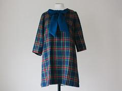 coat(0.0), pattern(1.0), textile(1.0), clothing(1.0), sleeve(1.0), outerwear(1.0), design(1.0), tartan(1.0), plaid(1.0),
