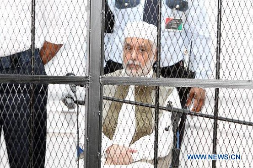 Prime Minister Al-Baghdadi Ali al-Mahmoudi sits in a cage. The former premier of Libya under Col. Muammar Gaddafi is to stand trial in a kangaroo court headed by US puppets. by Pan-African News Wire File Photos