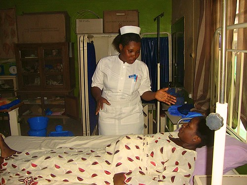 A student midwife giving health advice to a pregnant woman at the St Louis School of Midwifery, Zonkwa, Kaduna State, Nigeria