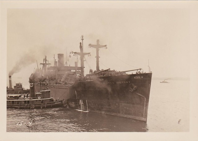 """<strong>SS Wheaton Victory in New York Harbor</strong> <br />  The Wheaton Victory merchant marine ship in New York Harbor,  August 3, 1946, full of American troops returning to the U.S.A. after World War II. The Wheaton Victory is being maneuvered into port by the tug <a title=""""Tug Boat Information"""" href=""""http://www.tugboatinformation.com/tug.cfm?id=4790"""" target=""""_blank"""">Card Boys</a> and other tugboats of Card Towing company. Image courtesy of Colin Smith."""