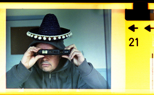 reflected self-portrait with Vivitar 742XL camera and small sombrero by pho-Tony