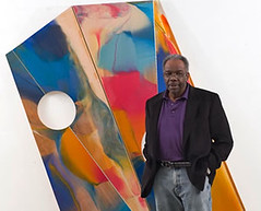 Sam Gilliam in front of one of his paintings (courtesy of U of Louisville College of Arts and Sciences)