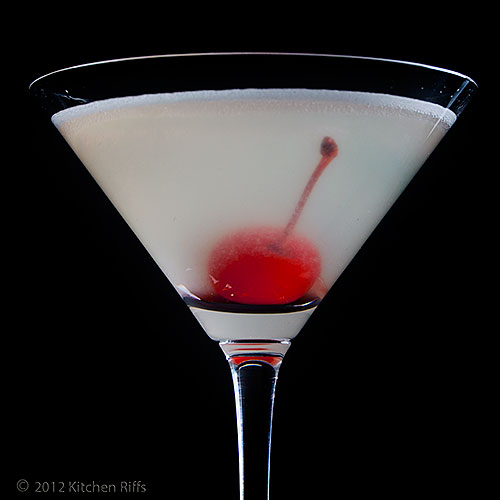 Aviation Cocktail with Maraschino Cherry Garnish, Black Background