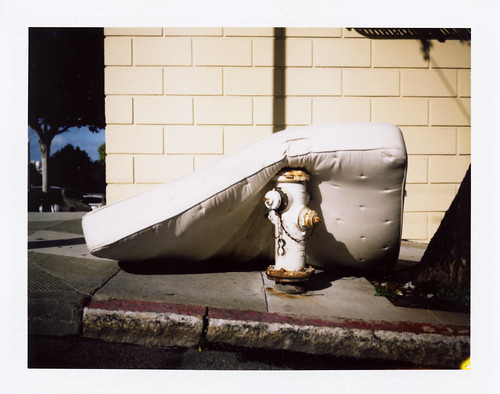 mattress laying on hydrant