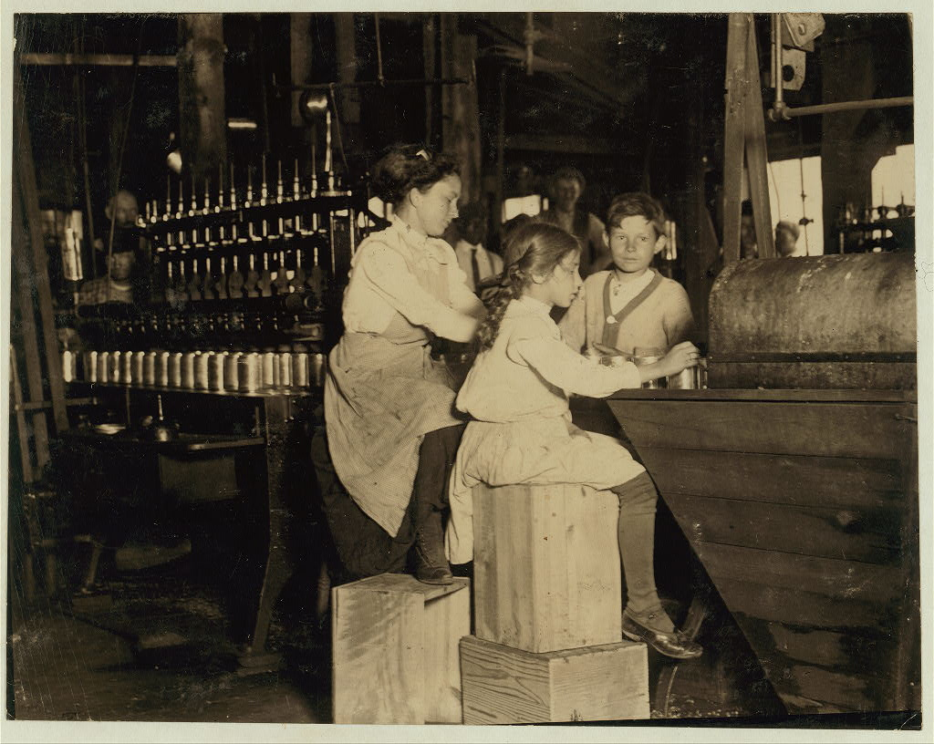"Daisy Langford, 8 yrs. old works in Ross' canneries. She helps at the capping machine, but is not able to ""keep up."" She places caps on the cans at the rate of about 40 per minute working full time. This is her first season in the cannery. Location: Seaford, Delaware."