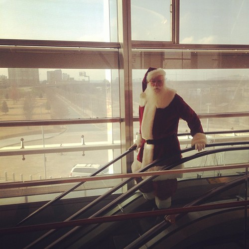 Santa on the escalator. His beard is real and his name is actually Carol. He's amazing!