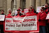 "With their mouths taped shut, RNs protest Gov. Snyder's ""Right to Work"" corporate takeover"