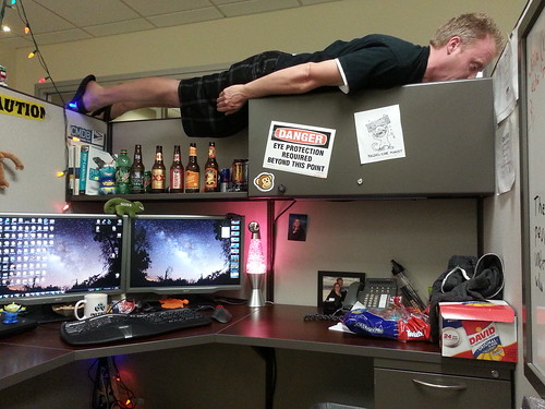 Planking on top of my cubicle.