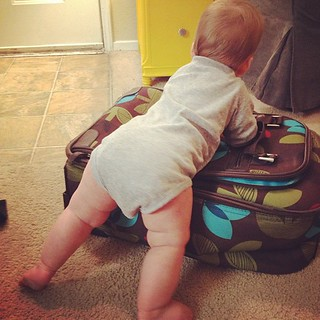Packing her suitcase.