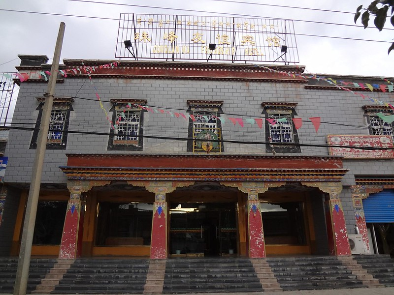 Photograph of the facade of the Hotel Friendship Qomolangma in Tibet Shigatse