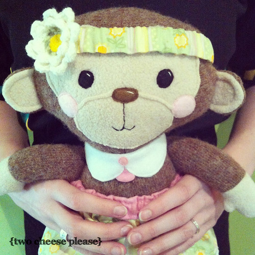 monkey soft toy held in hands