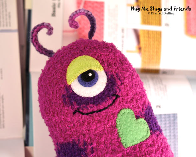 Slugterra and magenta polka-dotted sock Hug Me Slug, original stuffed animal art toy by Elizabeth Ruffing
