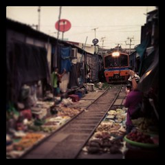 The Maeklong market is partially built by the rails.
