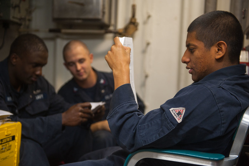 Sailors study for their Enlisted Surface Warfare Specialist (ESWS) qualification board