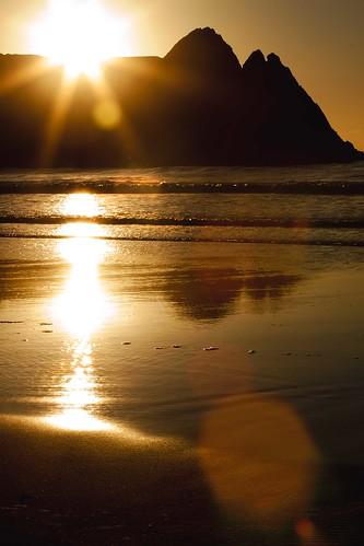 light sunrise lens golden bay three sand rocks surf day waves cliffs flare sunburst gower swanesa