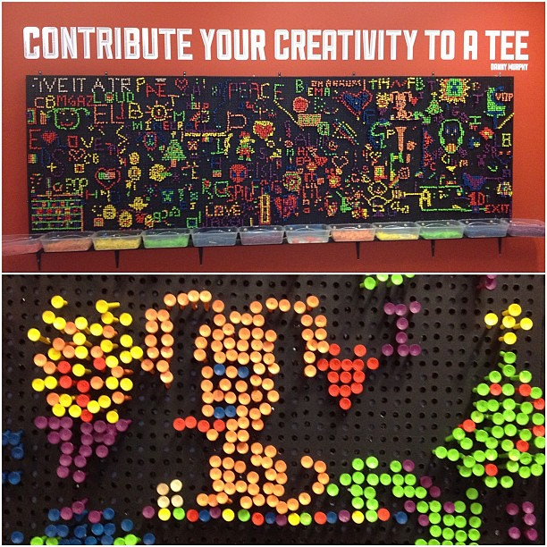 Lite Brite idea board using golf tees and a peg board in front of styrofoam (at the Idea Box in Oak Park Public Library)