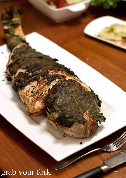 charcoal grilled snapper wrapped in fig leaves at stomachs eleven dinner party christmas 2012