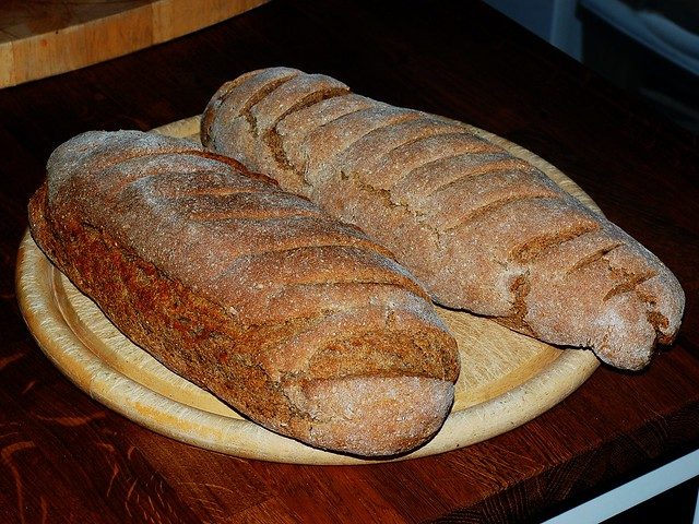 Two loaves of rye bread baked with slightly different recipes