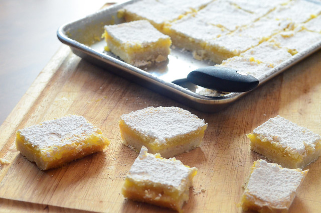 Mom's Lemon Bars with several slices placed on a cutting board.