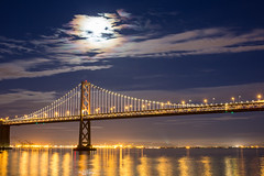 Bay Bridge at night with the moon out