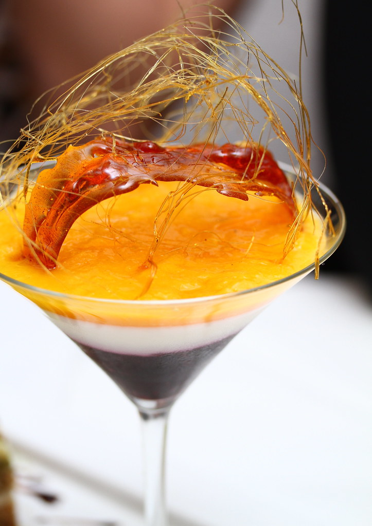 Etna Italian Restaurant & Pizzeria: Bi-coloured panna cotta in a glass with mango and mixed berries
