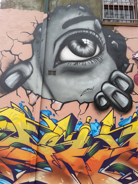 looking through gap in fabric of reality - Newtown, Sydney street art