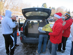 Pat Woodcock and his young athletes loading volunteers' cars.
