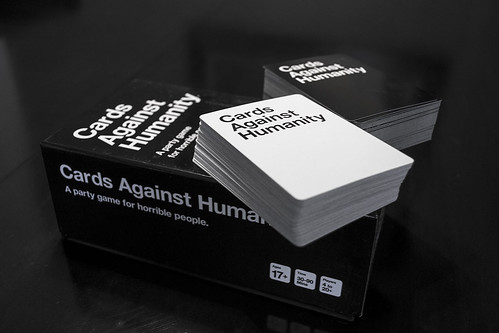 "image of black-and-white cards and a box reading ""Cards Against Humanity"""
