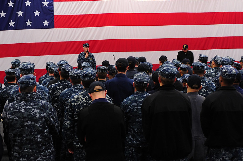Rear Admiral Gerard Hueber, commander of Expeditionary Strike Group (ESG) 3, delivers remarks to Sailors aboard USS Boxer
