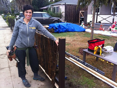 Our neighbor, Maria, builds a fence