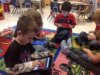Children using iPads in the classroom
