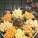 A treat for the eyes, this gourmet selection of cheeses include Swiss, Colby, mild brick, Muenster, pepper jack and salami cheeses with a scrumptious cheese ball.