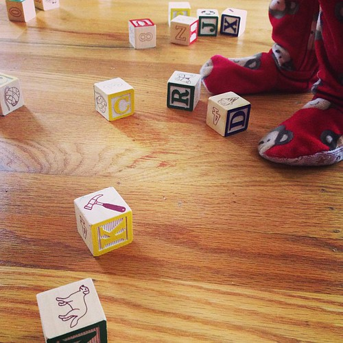 I broke out a set of blocks for M and now all I hear is wood crashing on wood (with giggles).