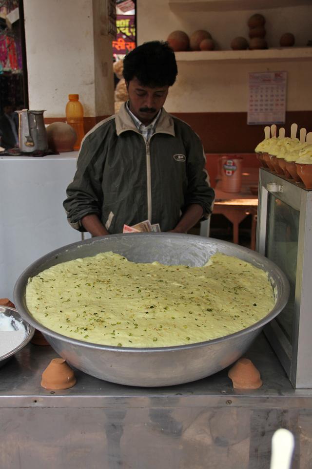 A vendor in Varanasi serving maiyoo - a foam milk dessert