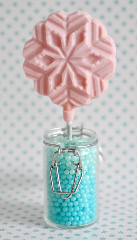 Pink chocolate snowflake lollipop