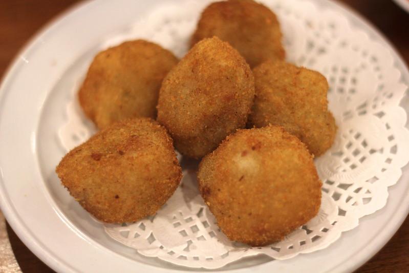 Savoury potato dumplings, crumbed and deep fried
