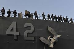 Sailors man the rails as USS Germantown (LSD 42) departs Sasebo, Japan, Jan. 15 for a Western Pacific patrol. (U.S. Navy photo by Mass Communication Specialist 2nd Class Adam M. Bennett)