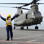Flight Deck Crew Marshalling a Chinook Helicopter
