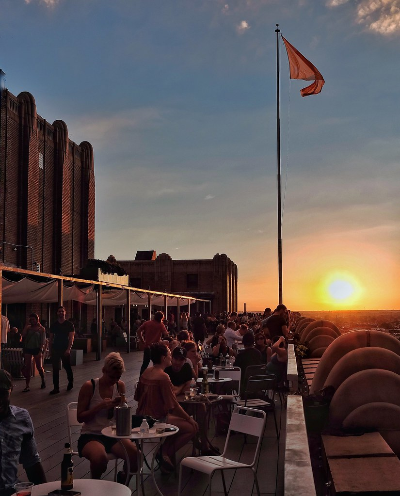 Men Sunset Flag Identity Sitting Person Tower Sun National Flag Skyscraper Sky Tall - High City Life Collection Arrangement Rooftop Quality Time Enjoying Life BOK Bar Philly Phillylove ❤️ Mobilephotography FUJIFILM X-T1 at Bok Bar