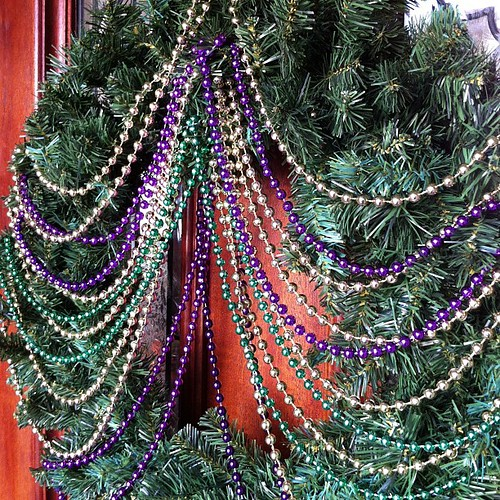 Inspired by the lovely @lsumel, I started to create our 2013 Mardi Gras wreath! All I need is a fun piece to go at the top-a mask or something. Suggestions?