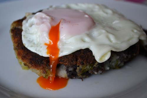 black pudding cabbage potato cake with fried egg