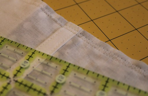 sew with straight stitch and then again with zig zag stitch all the way around