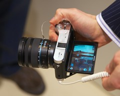 "The Samsung NX 300 with tillable 84mm (3.31"") AMOLED screen"